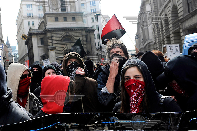 Demonstrators arrive at the Bank of England as thousands of protestors descended on the City of London ahead of the G20 summit of world leaders to express anger at the economic crisis, which many blame on the excesses of capitalism.