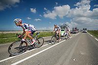 Jonas Van Genechten (BEL) &amp; Tim Wellens (BEL) escorting André Greipel (DEU) back into the peloton<br /> <br /> Eneco Tour 2013<br /> stage 3: Oosterhout - Brouwersdam (187km)