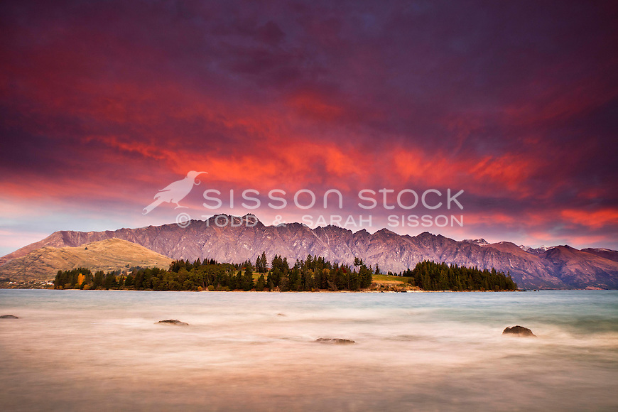 Looking across to Kelvin Heights and the Remarkables from Queenstown Gardens at sunset, South Island, New Zealand