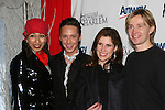 Tamara Tunie poses with Olympic skaters Johnny Weir, Melissa Gregory and Denis Petukov at the 2009 Skating with the Stars - a benefit gala for Figure Skating in Harlem on April 6, 2009 at Wollman Rink, Central Park, NYC, NY. (Photo by  Sue Coflin/Max Photos)