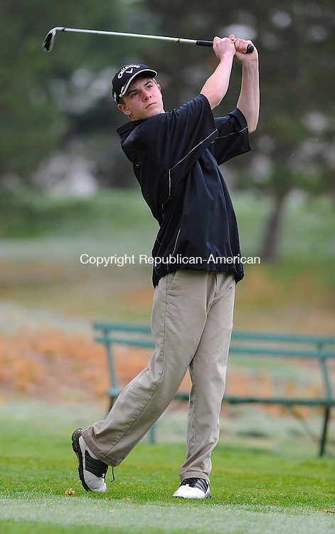 PLYMOUTH, CT-050814JS13--Gilbert's Brian Huber tees off during their golf match against Litchfield, Terryville and Nonnewaug Thursday at Pequabuck Golf Course.<br /> Jim Shannon Republican-American