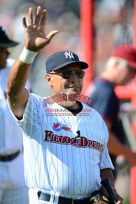 Hall of Fame outfielder Reggie Jackson #44 waves to the crowd before the MLB Pepsi Max Field of Dreams game on May 18, 2013 at Frontier Field in Rochester, New York.  (Mike Janes/Four Seam Images)