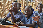 Children in a temporary school classroom in Jean-Rabel in northwestern Haiti. Their elementary school was heavily damaged during Hurricane Matthew in 2016, but Church World Service, a member of the ACT Alliance, is helping the community repair the school.