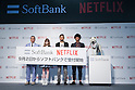 (L to R) American TV producer Dave Spector, model Dakota Rose, comedians Hiroshi Shinagawa and Tomoharu Shoji  and SoftBank's mascot dog ''Otosan'' (father) pose for the cameras during a media event to announce a business alliance for the Netflix video delivery service in Japan on August 24, 2015, Tokyo, Japan. From September 2nd SoftBank's 37 million users will be able to access a Netflix Inc. subscription starting at 650 JPN (5.34 USD) for a Standard SD plan. The companies also plan to work on joint content creation projects. (Photo by Rodrigo Reyes Marin/AFLO)