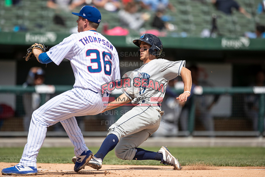 Lake County Captains third baseman Jesse Berardi (17) slides home before South Bend Cubs pitcher Riley Thompson (36) can tag him on May 30, 2019 at Four Winds Field in South Bend, Indiana. The Captains defeated the Cubs 5-1.  (Andrew Woolley/Four Seam Images)