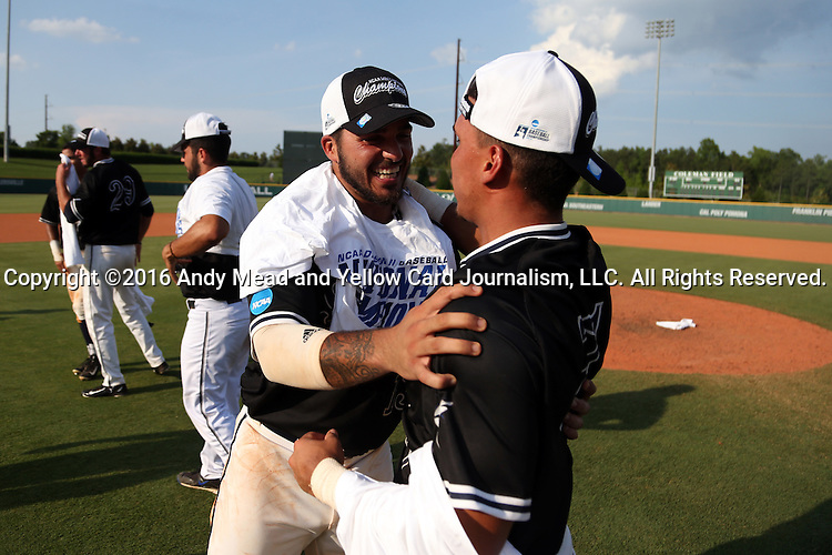 04 June 2016: Nova Southeastern players celebrate after the game. The Nova Southeastern University Sharks played the Millersville University Marauders in Game 14 of the 2016 NCAA Division II College World Series  at Coleman Field at the USA Baseball National Training Complex in Cary, North Carolina. Nova Southeastern won the game 8-6 and clinched the NCAA Division II Baseball Championship.