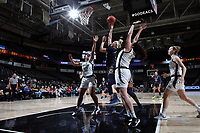 WINSTON-SALEM, NC - FEBRUARY 06: Sam Brunelle #33 of the University of Notre Dame takes a shot in traffic during a game between Notre Dame and Wake Forest at Lawrence Joel Veterans Memorial Coliseum on February 06, 2020 in Winston-Salem, North Carolina.