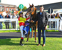 Jockey Emily Easterby and groom pose with Relight my Fire in the winners enclosure after winning The Mercedes-Benz of Salisbury Handicap (For Lady Amateur Riders)  tConnect during Twilight Racing at Salisbury Racecourse on 14th September 2018