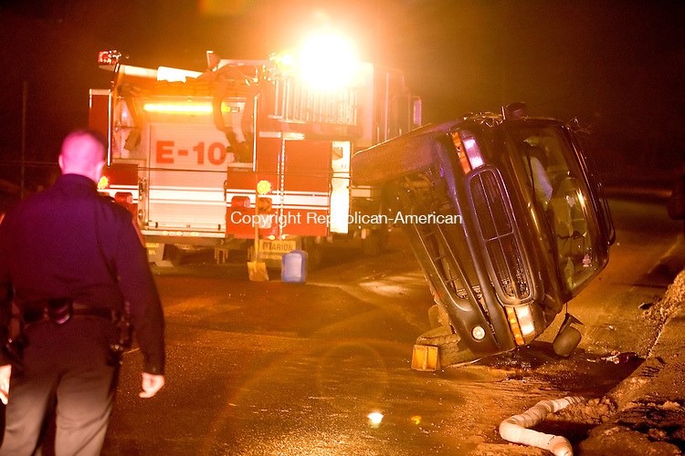 THOMASTON, CT  16 FEBRUARY 2005 -021606JS08-Thomaston police and fire were on the scene of a one-vehicle roll over accident on Route 6 in Thomaston late Thursday.   --- Jim Shannon Republican-American --B.J. Monteiro; Crosby, Holy Cross  are CQ
