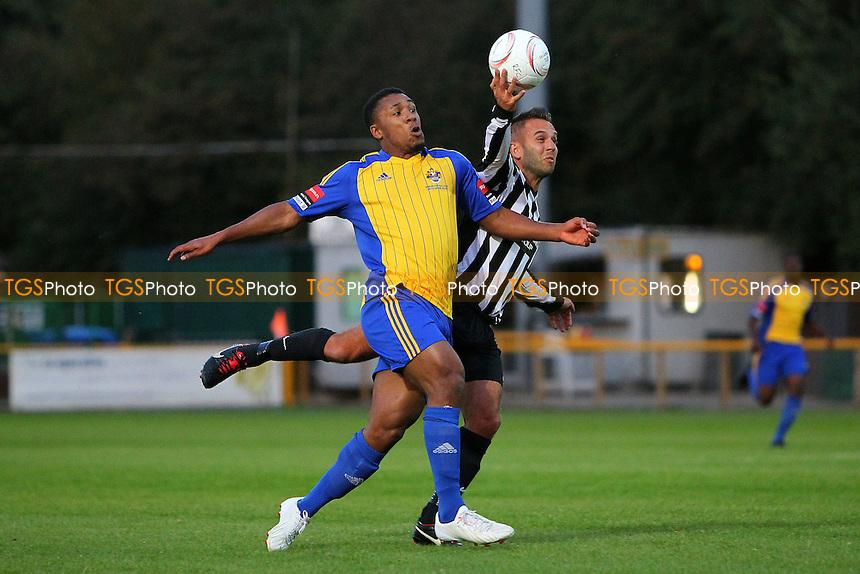 Olly Willis of Dereham handles the ball as Ryan Imbert closes him down - Romford vs Dereham Town - Ryman League Divison One North Football at Ship Lane, Thurrock FC, Purfleet, Essex - 20/08/14 - MANDATORY CREDIT: Gavin Ellis/TGSPHOTO - Self billing applies where appropriate - contact@tgsphoto.co.uk - NO UNPAID USE