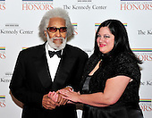 Sonny Rollins and his friend, Terri Hinte, arrives for the formal Artist's Dinner honoring the recipients of the 2011 Kennedy Center Honors hosted by United States Secretary of State Hillary Rodham Clinton at the U.S. Department of State in Washington, D.C. on Saturday, December 3, 2011. The 2011 honorees are actress Meryl Streep, singer Neil Diamond, actress Barbara Cook, musician Yo-Yo Ma, and musician Sonny Rollins..Credit: Ron Sachs / CNP