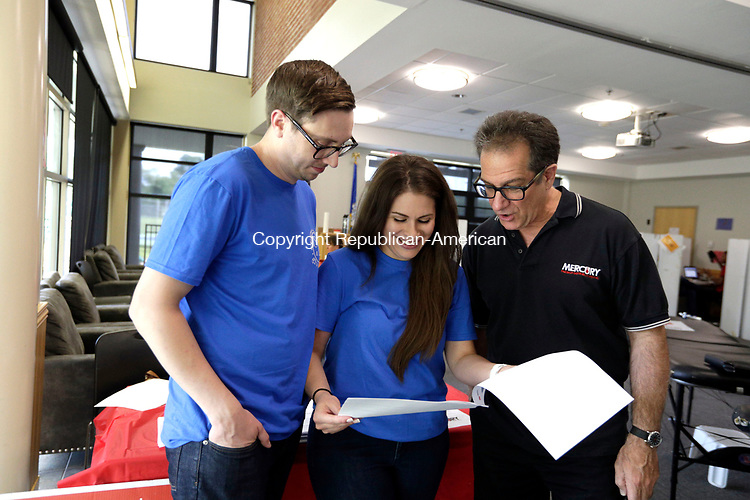 Waterbury, CT- 01 August 2017-080117CM02-  From left, David Devino Jr., his wife Stephanie and their uncle Thomas Devine, and brother to David Devine Sr. talk about the 5th annual David G. Devino Sr. blood drive at Chase Collegiate in Waterbury on Tuesday.    The annual event is held to honor Devino's memory by giving back to others, and raising awareness for autoimmune blood disorders and blood cancers.   Christopher Massa Republican-American