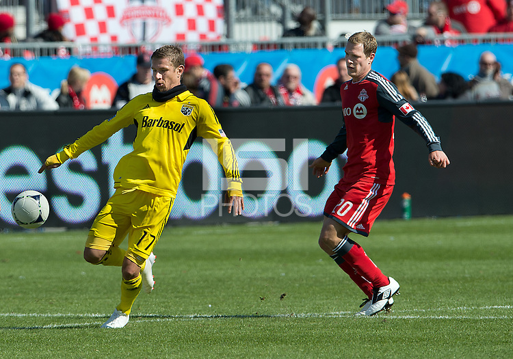 31 March 2011: Columbus Crew forward Olman Vargas #17 and Toronto FC defender Ty Harden #20 in action during a game between the Columbus Crew and the Toronto FC at BMO Field in Toronto, Ontario Canada..The Columbus Crew won 1-0.