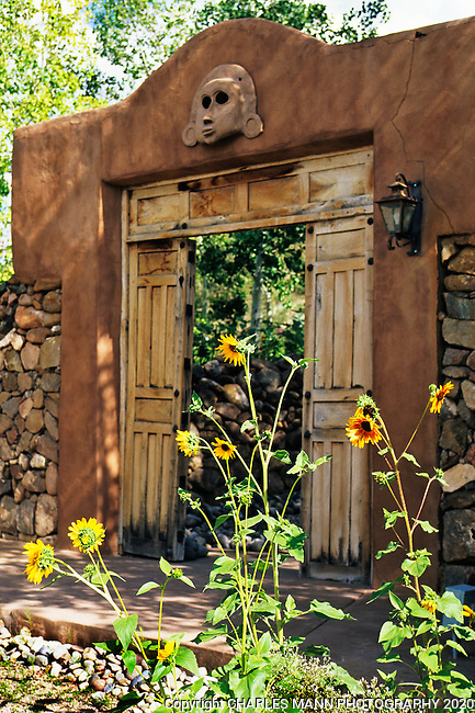 The gardens of Santa Fe,New Mexico, offer a constant suppply of delightful surprises and artful delights. Actor and bon vivant Mel Fillini styled his Santa Fe garden complund after the famous Mexican architect Louis Barragan.