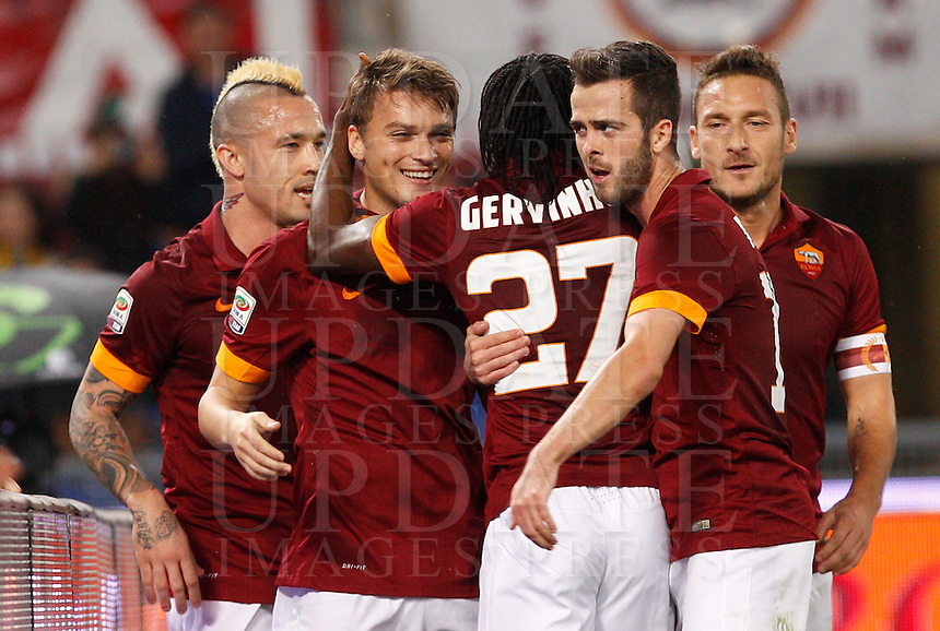 Calcio, Serie A: Roma vs Inter. Roma, stadio Olimpico, 30 novembre 2014.<br /> Roma&rsquo;s Gervinho, center, celebrates with teammates, from left, Radja Nainggolan, Adem Ljajic, Miralem Pjanic and Francesco Totti after scoring during the Italian Serie A football match between AS Roma and FC Inter at Rome's Olympic stadium, 30 November 2014.<br /> UPDATE IMAGES PRESS/Riccardo De Luca