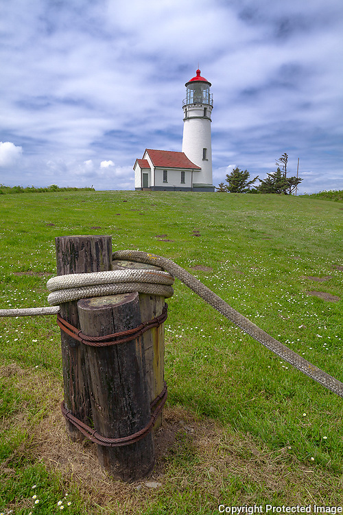 Cape Blanco State Park, Oregon<br /> Cape Blanco Light (1870) on a Pacific coast meadow