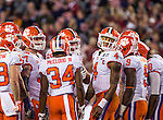 Clemson quarterback Deshaun Watson (4) glances at the Alabama defense from the huddle in the first half of the 2017 College Football Playoff National Championship in Tampa, Florida on January 9, 2017.  Photo by Mark Wallheiser/UPI