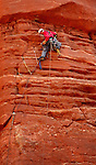 Marcus Garcia works a traverse on Echo Tower.  Garcia is attempting to summit all five Fisher Towers in one day.  Photo taken Saturday, March 27, 2004 near Moab, Utah..Star-Telegram/Khampha Bouaphanh