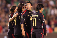 Mexico national team defender Edgar Duenas (20) looks back towards Memo for help. The national teams of Mexico and Venezuela played to a 1-1 draw in an International friendly match at  Qualcomm stadium in San Diego, California on  March 29, 2011...