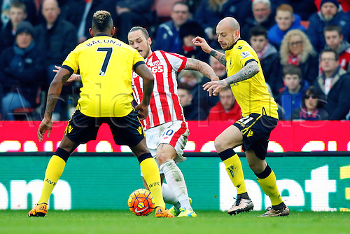 27.02.2016. Britannia Stadium, Stoke, England. Barclays Premier League. Stoke City versus Aston Villa. Marko Arnautovic of Stoke City is watched by Alan Hutton of Aston Villa and Leandro Bacuna of Aston Villa