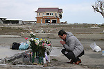 March 11, 2016, Tokyo, Japan - A man offers a prayer for the victims of tsunami and earthquake on the area destroyed by the tsunami at Namie in Fukushima prefecture near the crippled TEPCO's nuclear plant on Friday, March 11, 2016 on the fifth anniversary of the Great East Japan Earthquake and Tsunami.  (Photo by Yoshio Tsunoda/AFLO)