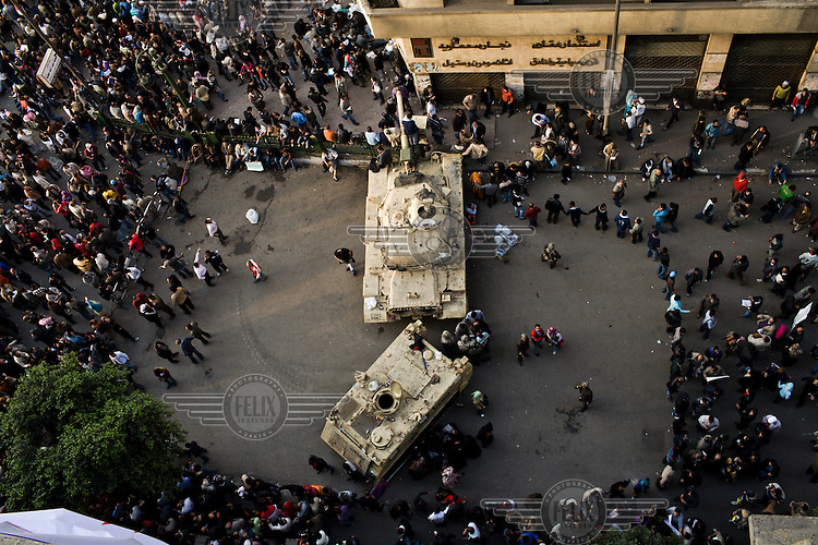 Protestors surround a tank and an armoured vehicle that have been stationed in Tahrir Square. 25 January 2011 saw the beginning of a nationwide 18 day protest movement that eventually ended the 30-year rule of Hosni Mubarak and his National Democratic Party.