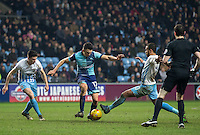 Marcus Tudgay of Coventry City tackles Adebayo Akinfenwa of Wycombe Wanderers during the The Checkatrade Trophy - EFL Trophy Semi Final match between Coventry City and Wycombe Wanderers at the Ricoh Arena, Coventry, England on 7 February 2017. Photo by Andy Rowland.