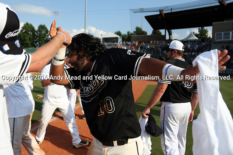 04 June 2016: Nova Southeastern's Andres Visbal daps with a teammate. The Nova Southeastern University Sharks played the Millersville University Marauders in Game 14 of the 2016 NCAA Division II College World Series  at Coleman Field at the USA Baseball National Training Complex in Cary, North Carolina. Nova Southeastern won the game 8-6 and clinched the NCAA Division II Baseball Championship.
