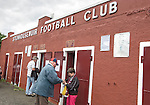 An Alloa Athletic football supporters buying a half-time draw ticket outside the away end at Ochilview stadium, Larbert, before his team's Irn Bru Scottish League second division match against Stenhousemuir. Alloa won the match by one goal to nil against their local rivals in a match watched by 619 spectators.