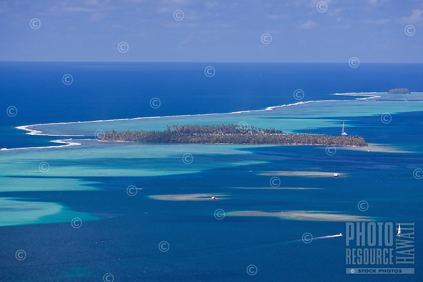 View of islands, pass, and surrounding reefs from Raiatea island