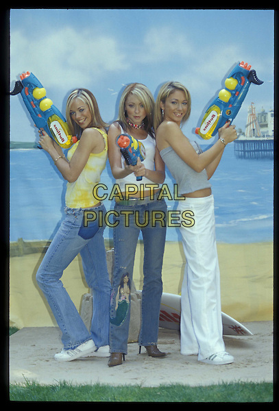 ATOMIC KITTEN.26 July 2001.Ref: 10992.water guns, posing, full length, full-length.*RAW SCAN- photo will be adjusted for publication*.www.capitalpictures.com.sales@capitalpictures.com.©Capital Pictures