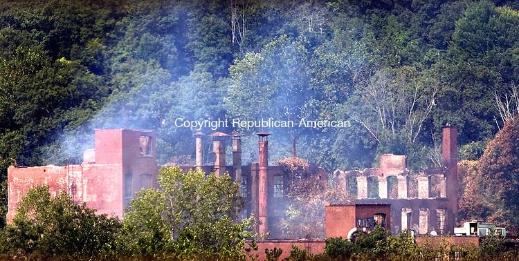 WATERBURY CT. 17 August 2015-081815SV01-Bristol Babcock factory building is still smoking on Bristol Street in Waterbury Tuesday.<br /> Steven Valenti Republican-American