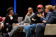 January 12, 2012  (Washington, DC)  Radio and television talk show host Tavis Smiley (center) moderated a panel discussion on restoring America's prosperity at the George Washington University Lisner Auditorium in Washington. (L-R) Dr. Cornell West, Michael Moore, Suze Orman, Vicki Escarra (not pictured), Roger Clay, Jr.  (Photo by Don Baxter/Media Images International)