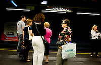 Passengers wait for the subway in Naples, Italy...PHOTOS/ MATT NAGER