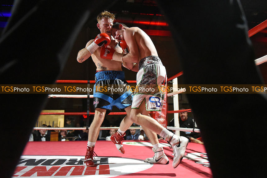Georgie Wright (white/black shorts) defeats Jamie Carley during a Boxing Show at Tolworth Recreation Centre on 9th December 2016