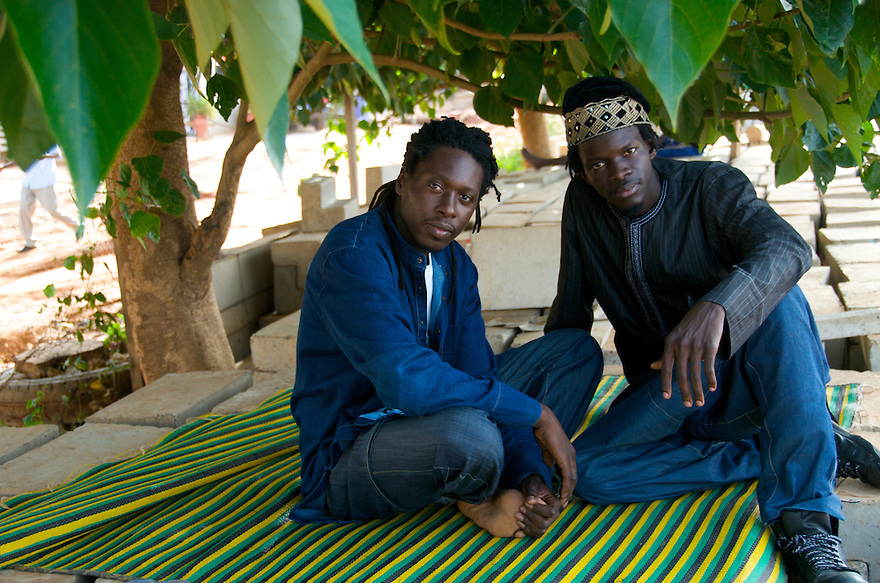 Dakar, Senegal -  Members of Daara J, a Senegalese Hip Hop group, pose outside of their studio in Dakar. Daara J contributed an exclusive track, 'Unite 75' to the compilation, 'Yes We Can! Songs About Leaving Africa.'