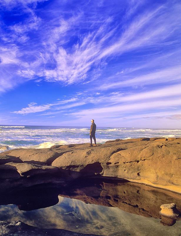 Hiker and reflecting pool. Smelt Sands State Park, Oregon