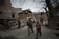 Young villagers talk with marines as they patrol in Nishigham village in Nuristan. The day's mission was to re-supply an OP (Observation Post) that had been attacked the day before killing one ANA (Afghan National Army) soldier. The marines are acting as an ETT (Embedded Training Team) to mentor the ANA with the ultimate aim of leaving the country's security for the local Army to deal with.