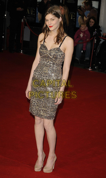 Amber Anderson.W.E. UK film premiere at Odeon cinema, Kensington, London, England..11th January 2011.full length silver beige grey gray leopard print dress shoes platform .CAP/CAN.©Can Nguyen/Capital Pictures.