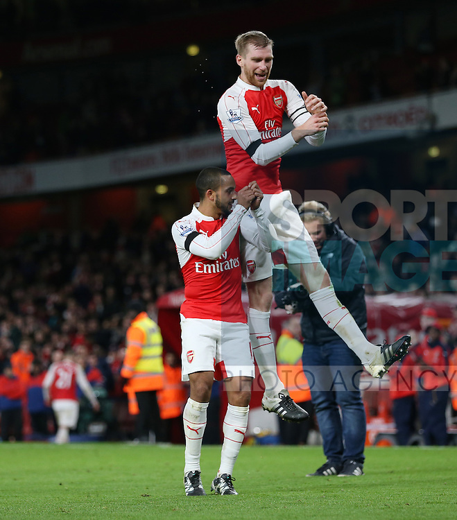 Arsenal's Theo Walcott and Per Mertesacker do their post match celebration<br /> <br /> Barclays Premier League- Arsenal vs AFC Bournemouth - Emirates Stadium - England - 28th December 2015 - Picture - David Klein/Sportimage