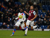 30th November 2019; Turf Moor, Burnley, Lanchashire, England; English Premier League Football, Burnley versus Crystal Palace; Jeffrey Schlupp of Crystal Palace breaks through on goal chased by Erik Pieters of Burnley - Strictly Editorial Use Only. No use with unauthorized audio, video, data, fixture lists, club/league logos or 'live' services. Online in-match use limited to 120 images, no video emulation. No use in betting, games or single club/league/player publications