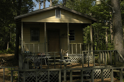 EXCLUSIVE***The small fishing cabinn on the lake, that was the burial site in the earthen dam on Olen Burrages property in Philadelphia,Ms. Friday June 17,2005. There has been no journalists who have ventured to the site in 40 years,until now. James Chaney,Michael Schwerner and Andrew Goodmans bodies were pulled from this site in 1964. Edgar Ray Killen is on trial for there murders.(Photo/Suzi Altman)