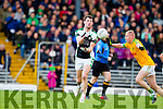 Bernard Walsh South Kerry in action against Padraig Lucey Legion at the Kerry County Senior Football Final at Fitzgerald Stadium on Sunday.