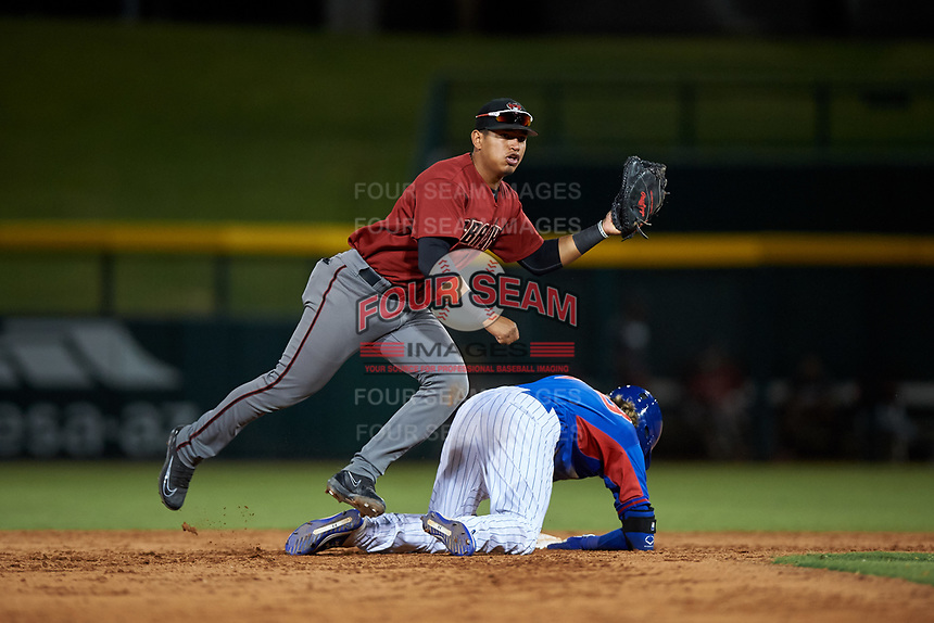AZL Dbacks first baseman Sergio Gutierrez (9) applies a late tag to Grayson Byrd (78) at second base during an Arizona League game against the AZL Cubs 2 on June 25, 2019 at Sloan Park in Mesa, Arizona. AZL Cubs 2 defeated the AZL Dbacks 4-0. (Zachary Lucy/Four Seam Images)
