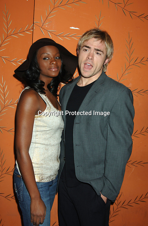 Tika Sumpter and John-Paul Lavoisier ..at the One Life To Live Christmas Party at LQ on     December 12, 2005. ..Photo by Robin Platzer, Twin Images