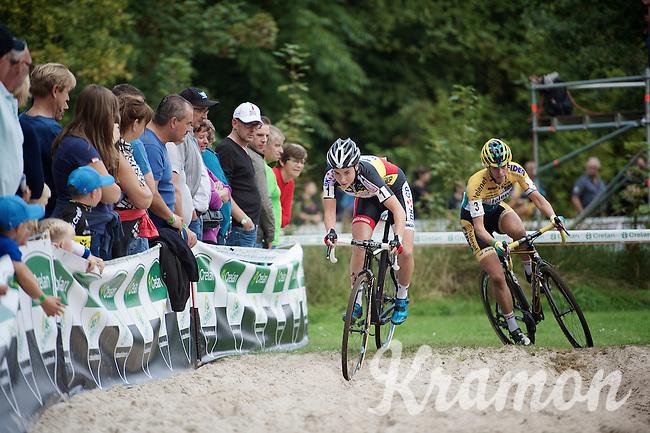 Sanne Cant (BEL/Ciclismo Mundial) hitting the sand first, Ellen Van Loy (BEL/Telenet-Fidea) following closely<br /> <br /> GP Neerpelt 2014
