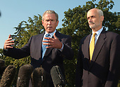 Washington, D.C. - September 2, 2005 -- United States President George W. Bush makes remarks before departing on his trip to view areas ravaged by Hurricane Katrina at the White House on September 2, 2005.  In his remarks the President said the relief efforts are not acceptable.  At right is United States Secretary of Homeland Security Michael Chertoff.<br /> Credit: Ron Sachs - Pool via CNP