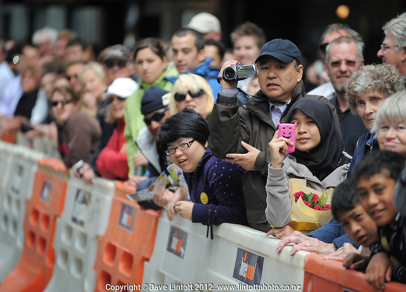 The crowd watches from behind barriers on Willis St during the 2012 Wellington IRB sevens parade in the Wellington CBD, Wellington, New Zealand on Thursday, 2 February 2012. Photo: Dave Lintott / lintottphoto.co.nz