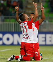VALPARAISO - CHILE - 13 - 02 - 2018: Wilson Morelo (Der.), jugador de Independiente Santa Fe, corre a celebrar el gol anotado a Santiago Wanderers, durante partido de ida entre Santiago Wanderers (CHL) y el Independiente Santa Fe (COL), de la fase 3 llave 1 por la Copa Conmebol Libertadores 2018, jugado en el estadio Bicentenario Elias Figueroa de la ciudad de Valparaiso. / Wilson Morelo (R), player of Independiente Santa Fe, runs to celebrates a scored goal to Santiago Wanderers, during a match of the first leg between Santiago Wanderers (CHL) and Independiente Santa Fe (COL), of the 3rd phase key 1 for the Copa Conmebol Libertadores 2018 at the Bicentenario Elias Figueroa Stadium in Valparaiso City, Photo: VizzorImage / Raul Zamora / Cont / Photosport