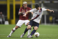Theo Hernandez of AC Milan and Riccardo Orsolini of Bologna FC compete for the ball during the Serie A football match between AC Milan and Bologna FC at stadio Giuseppe Meazza in Milano ( Italy ), July 18th, 2020. Play resumes behind closed doors following the outbreak of the coronavirus disease. <br /> Photo Image Sport / Insidefoto